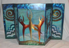 This miniature fireplace screen created by Ochoa Stained Glass in collaboration with fine metal sculptor Lynn Rae Lowe of LoweCoMotion Inc. illustrates how metal and glass can come together to create extraordinary adornments for your home interior and office. Contact us for pricing on a custom glass and metal fireplace screen for your home or office.