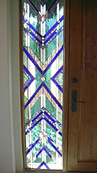 A stunning Mission style stained glass panel commissioned for the sidelight of the entryway to one of Tucson's grand Foothills homes.